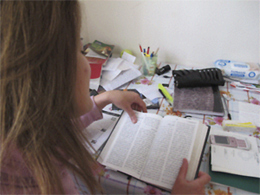 An Algerian woman reads the New Testament.