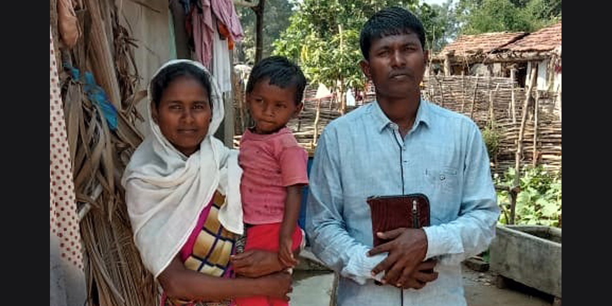 Pastor Munshi, wife and child - Photo: Morning Star News www.morningstarnews.org