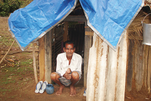 A man sitting at the door of his tent in a refugee camp in 2009.