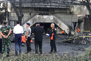 President Joko Widodo (in white) visited one of the churches that were attacked.