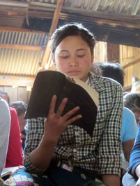 A Laotian believer reading her Bible - Photo: VOM USA www.icommittopray.com