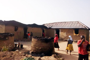 Christians survey the damage from a Fulani attack. - Photo: Release International www.releaseinternational.org