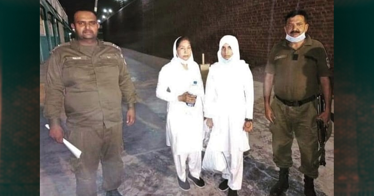 Maryam Lal and Navish Arooj with officers - Photo: Morning Star News