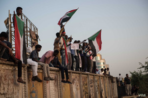 Sudanese people and flags